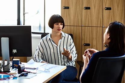 Businesswoman initiating an open conversation with her boss