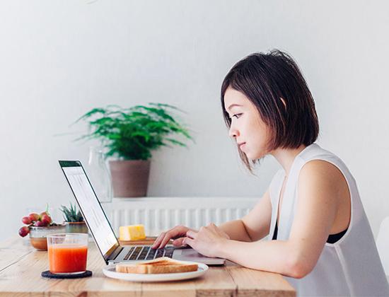 Young businesswoman logging into virtual public workshop