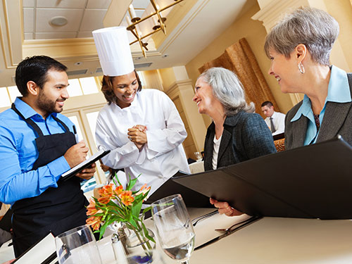 Customers thanking chef for meal