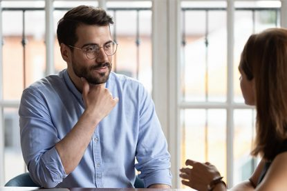businessman communicates thoughtfully with colleague about upcoming project